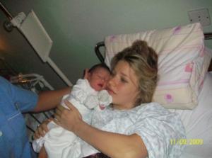 Ella at birth with mom image