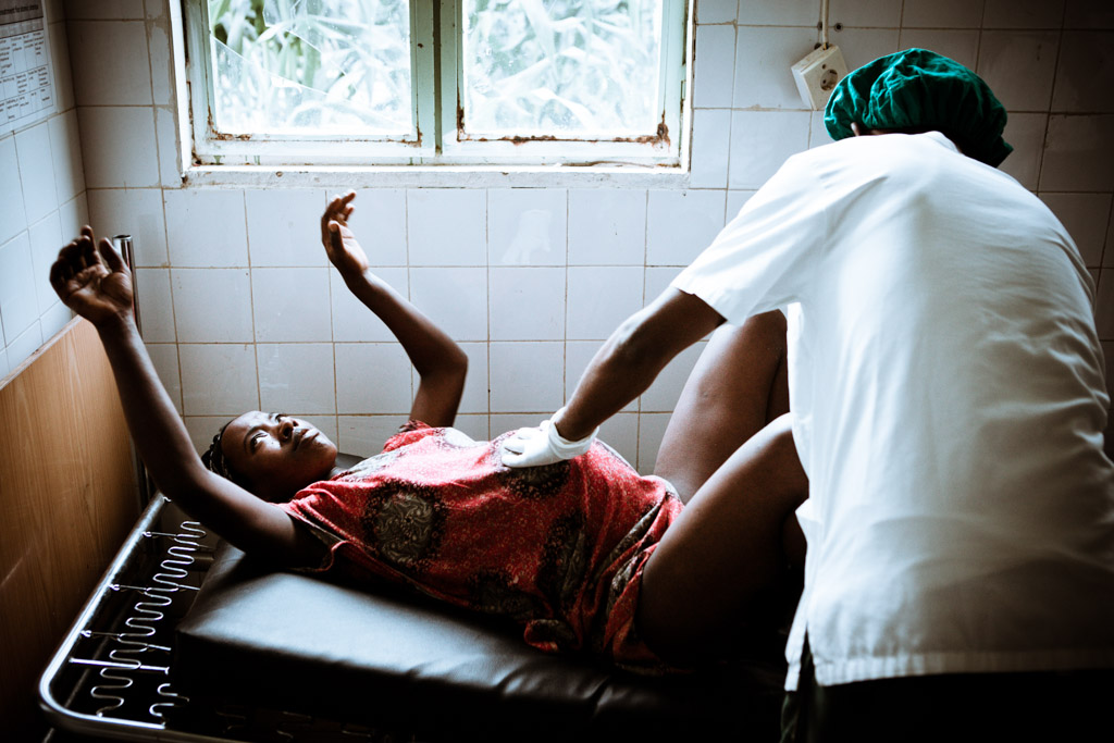 Woman in painful labour is almost ready to deliver. Jinka, Ethiopia